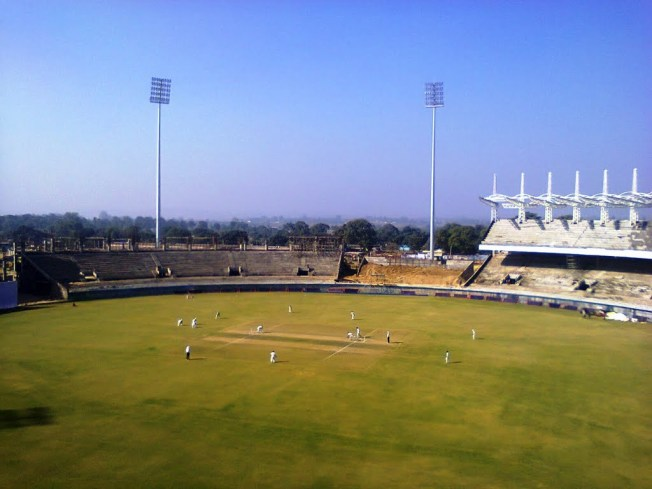 Playing Cricket In Stadium