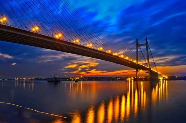 At night -reflection of the illuminated bridge