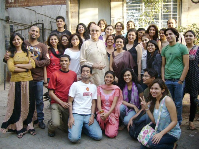 Kishore Namit Kapoor posing with his Students